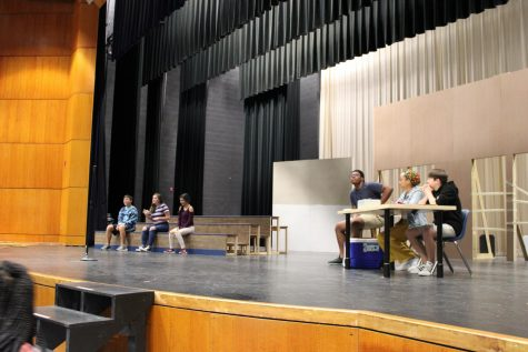 The actors prepare to rehearse their scene.