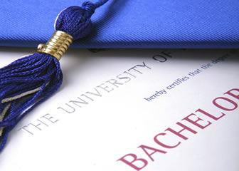 Blue graduation cap sitting on a bachelors degree. Bachelors written in red writing
