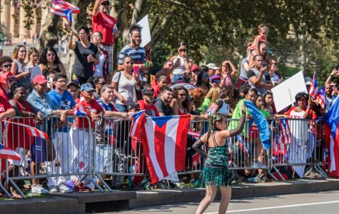 People are at a parade for Hispanic Heritage month